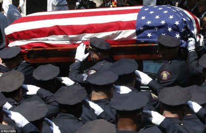 1405718634243_wps_18_Police_officers_salute_as